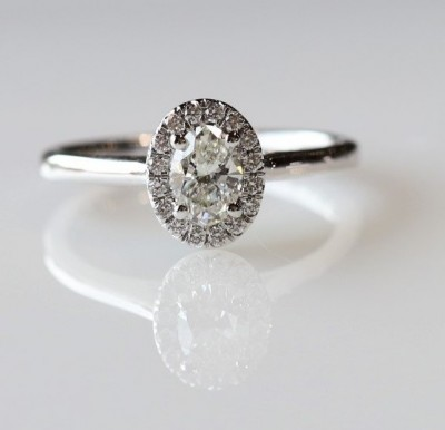 14Kw .66Cttw Oval Halo Diamond Engagement Ring