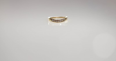 14ky .25cttw 7 stone Curved Channel Band