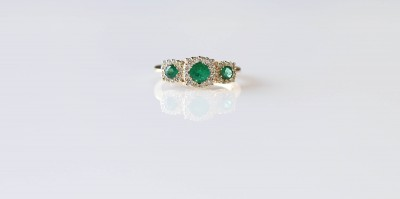 Triple Halo Emerald and Diamond Ring