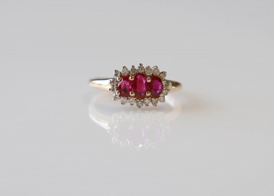 Oval 3 Stone Ruby and Diamond Halo Ring
