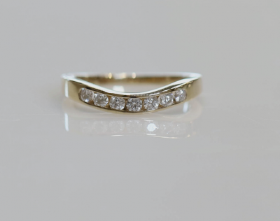 14ky .33cttw 7 Stone Curved Channel Band