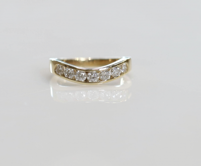 14ky .75cttw 7 Stone Curved Channel Band